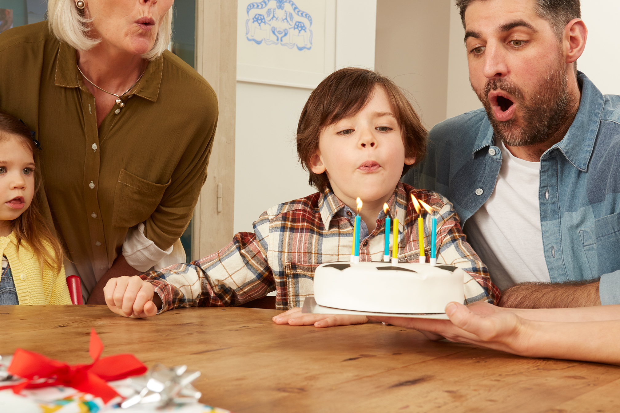 Family celebrating birthday of young son