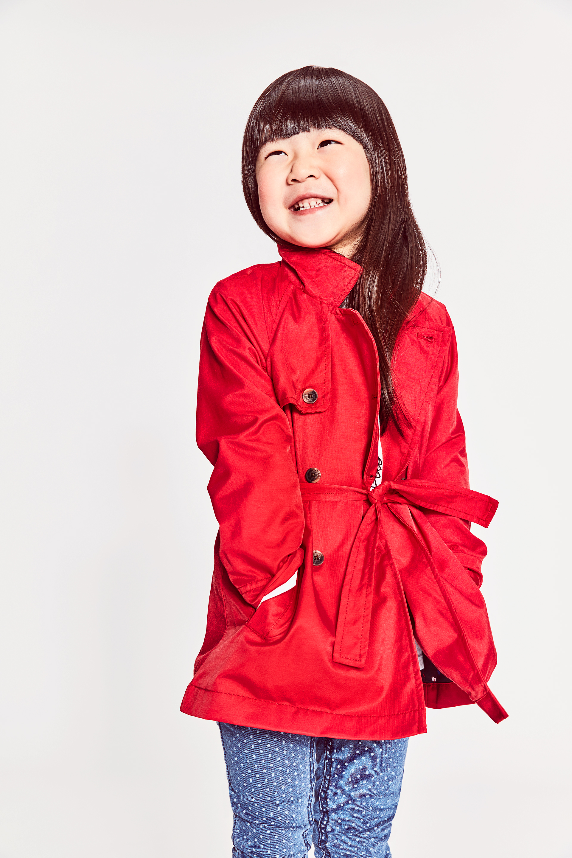 chinese girl bright red coat smiling kids fashion