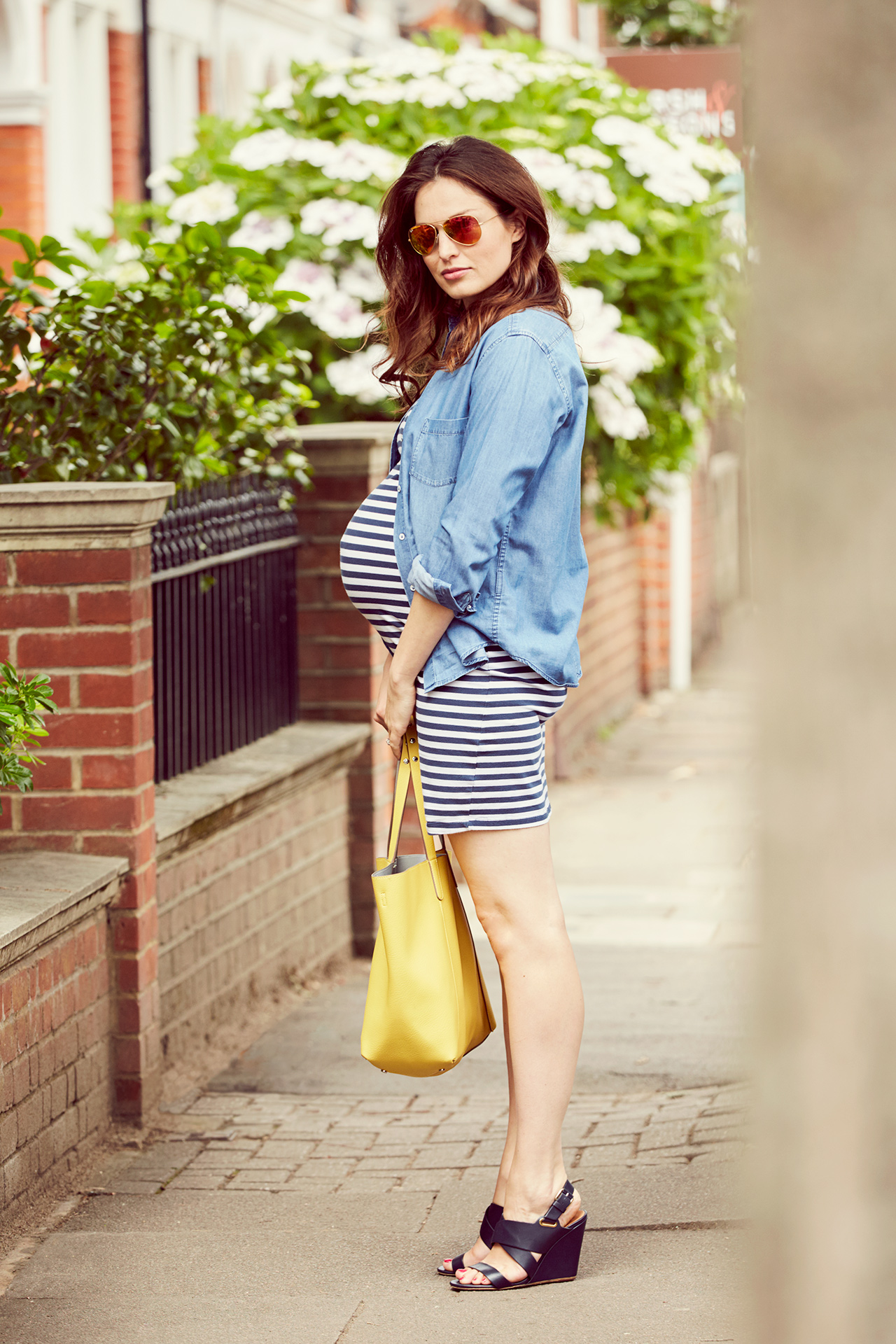 Pregnant mum poses with handbag