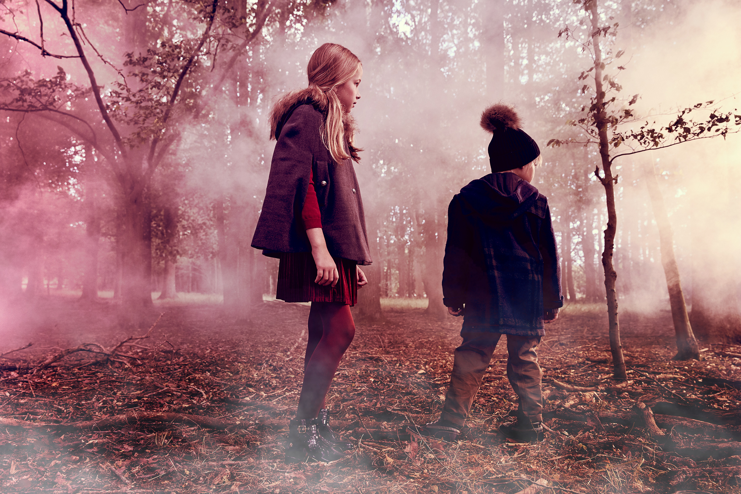 Boy and girl in woodland fashion story