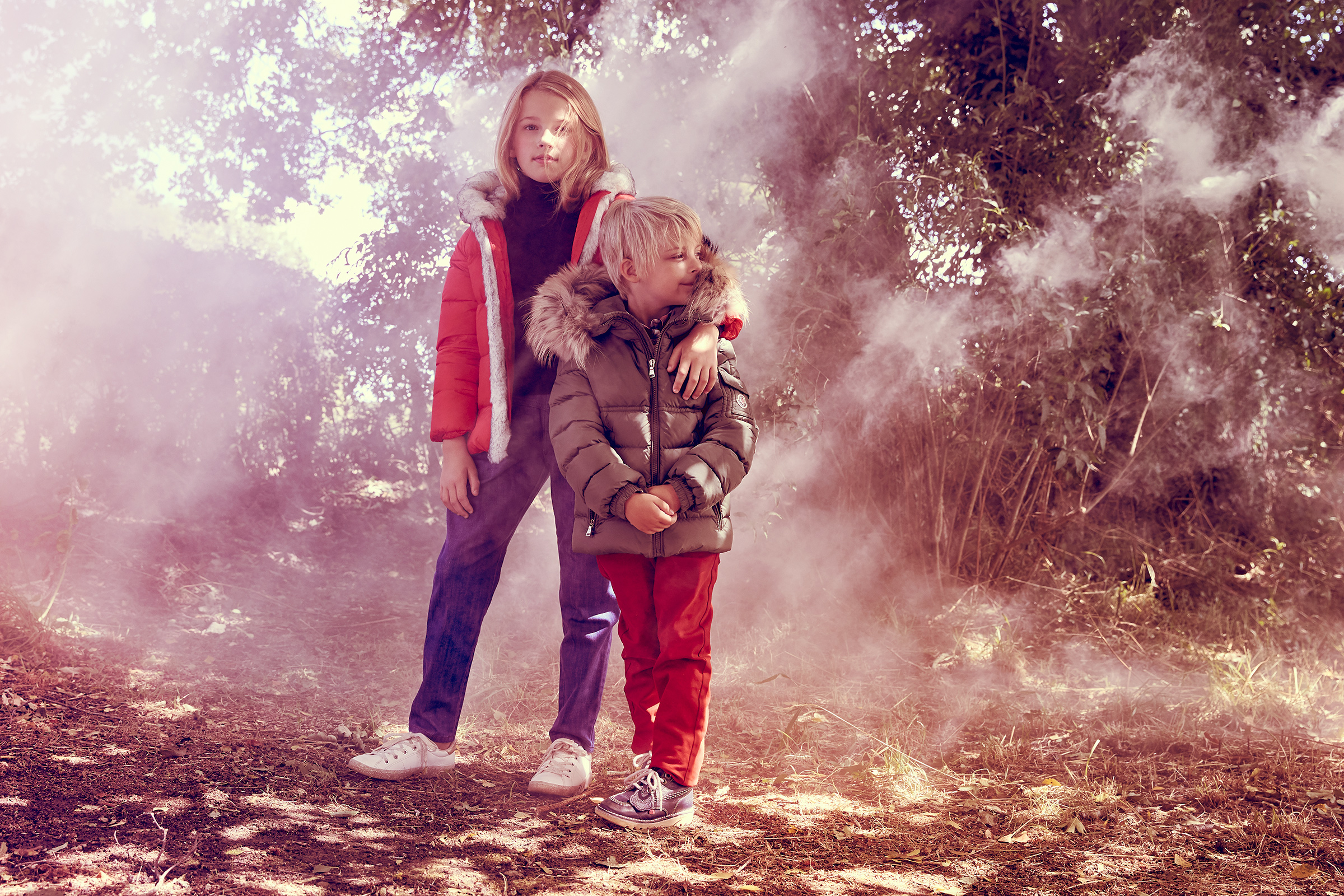 Boy and girl in magic woodland fashion story