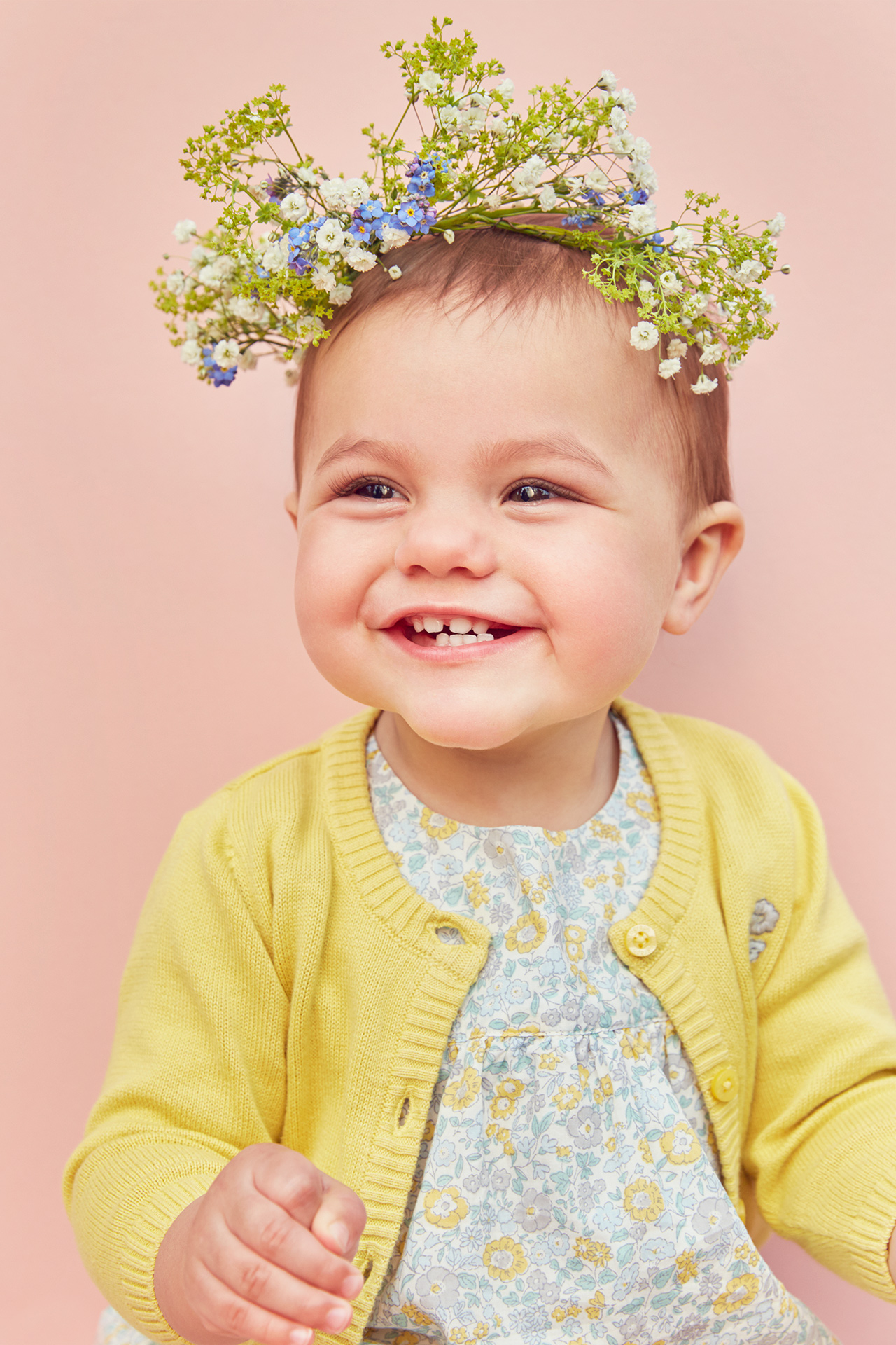 Marks and Spencers baby with floral headdress