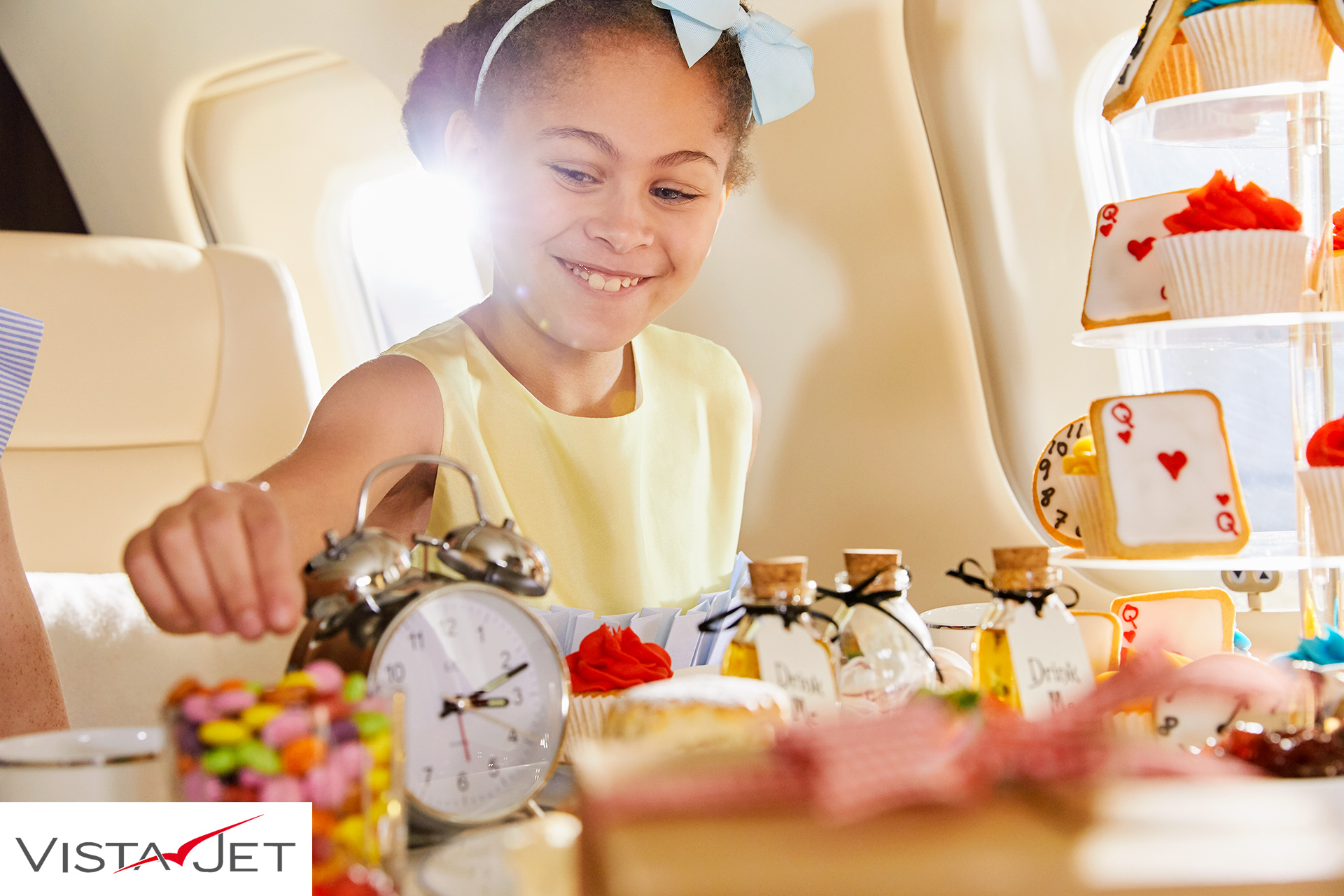 Child eating party food on a plane
