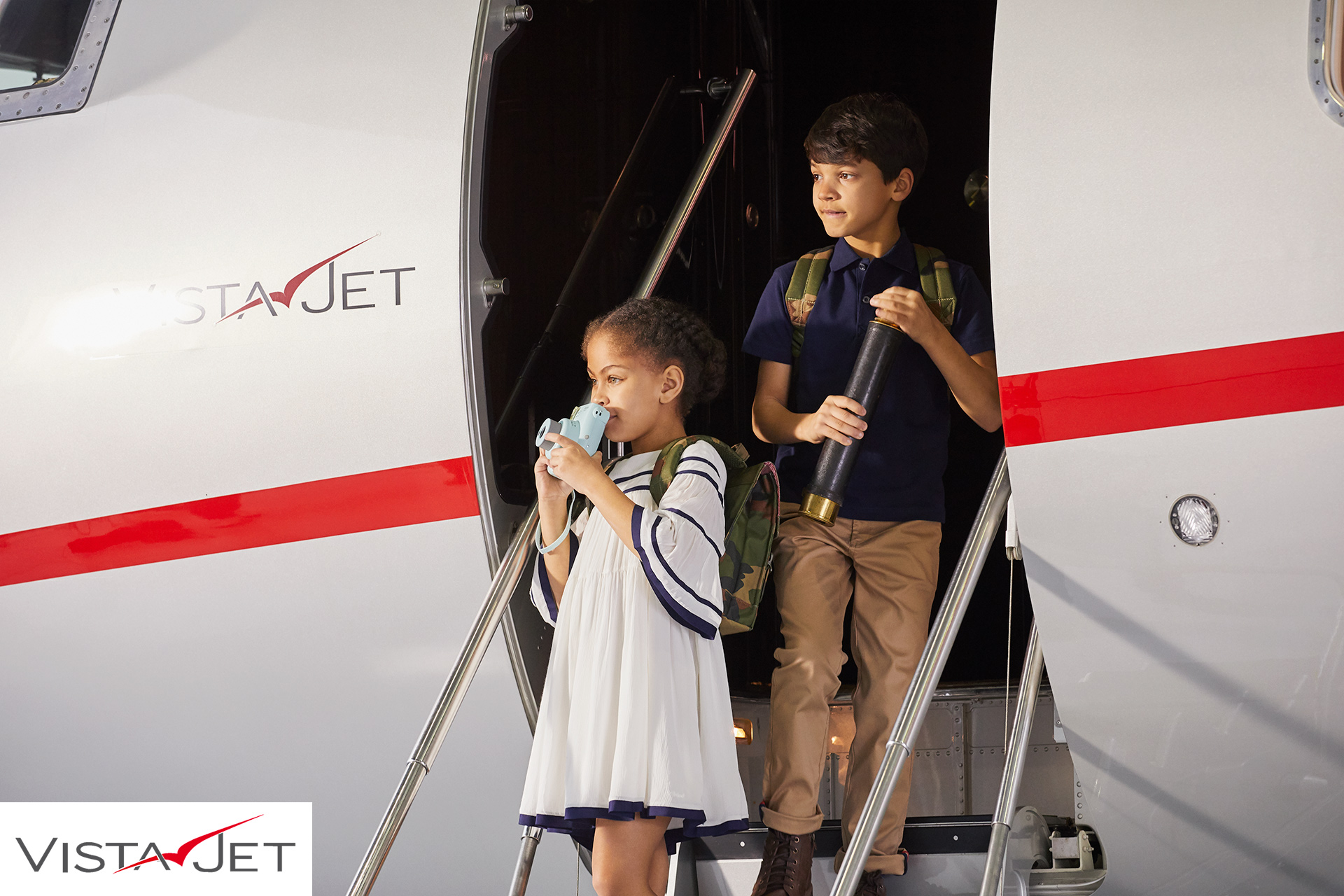 Children disembarking from plane