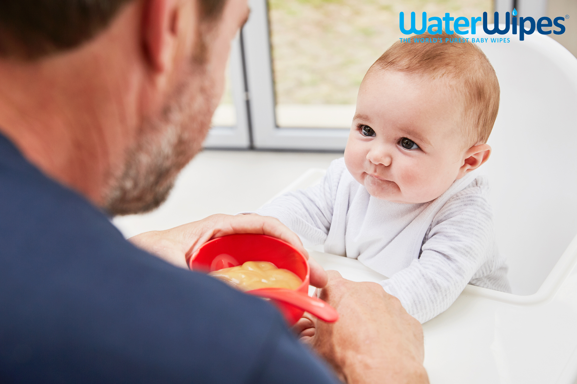 WaterWipes daddy feeding baby Emma Tunbridge
